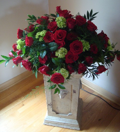 Red and Green Flowers in Vase
